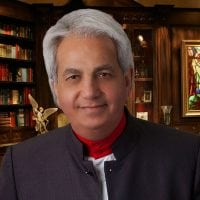 Pastor Benny Hinn in library